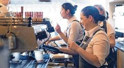 In demand: Baristas hard at work at a Coffee Angel café in Dublin. Ireland's growing coffee culture has seen the number of job vacancies for baristas soar in recent years. Stock Image