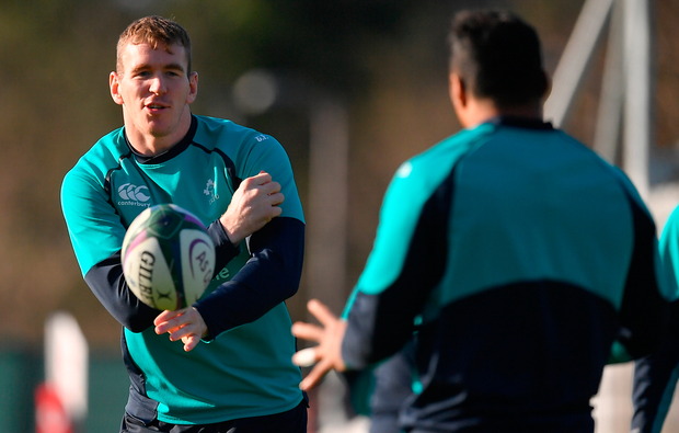 Centre of attention: Chris Farrell passes to Bundee Aki at training in Carton House. Photo: Sportsfile