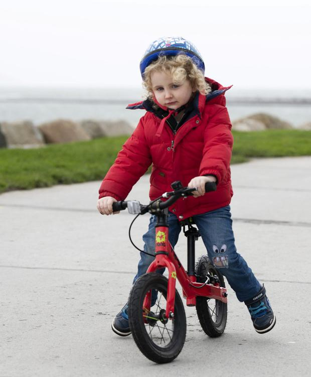 Carefree: Cian Hardiman (4), from Knocknacarra, Co Galway, goes for a cycle in the calm ahead of the storm in Salthill. Photo: Andrew Downes