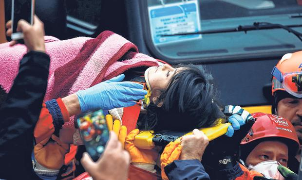 Rescued: 'God is great,' one of the crowd chanted as Havva Tekgoz (5) was pulled from the rubble. Photo: Huseyin Aldemir