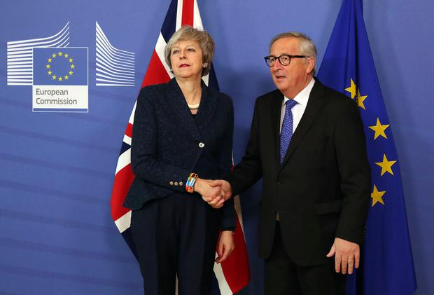 European Commission President Jean-Claude Juncker shakes hands with British Prime Minister Theresa May before their meeting at the European Commission headquarters in Brussels. AP Photo/Francisco Seco
