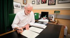 Labour leader Jeremy Corbyn signs a letter he has written to British Prime Minister Theresa May laying out Labour's five Brexit demands. Photo: PA