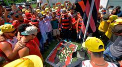 Tragedy: Fans gather to lay flowers at the entrance of the Flamengo training centre. Photo: Getty Images