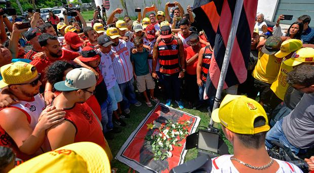 Youth team players among 10 killed in blaze at training centre of leading Brazilian soccer team