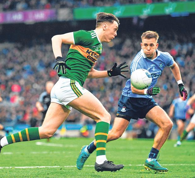 Rivlary on the rack: Kerry's David Clifford, currently on the sidelines, takes on Jonny Cooper of Dublin in last year's NFL clash. Photo: Sportsfile