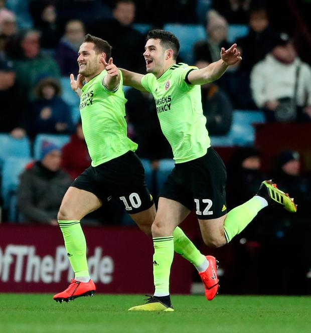 Sheffield United's Billy Sharp (left) celebrates scoring his side's first goal of the game during the Sky Bet Championship match at Villa Park, Birmingham. Photo: Nick Potts/PA Wire