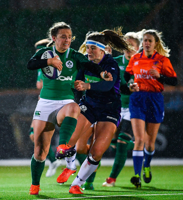 Michelle Claffey of Ireland is tackled by Helen Nelson of Scotland. Photo by Ramsey Cardy/Sportsfile