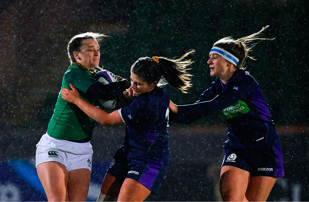 Michelle Claffey of Ireland is tackled by Lisa Thomson of Scotland. Photo by Ramsey Cardy/Sportsfile