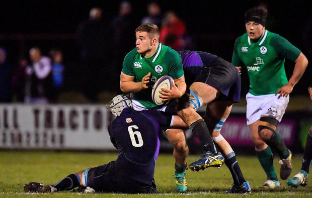 Scott Penny of Ireland is tackled by Charlie Jupp and Ewan Johnson of Scotland. Photo by Brendan Moran/Sportsfile