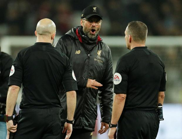 Seeing Red: Liverpool manager Jurgen Klopp speaks with match officials after their draw against West Ham. They have the chance to return to the top of the table today against Bournemouth. Photo: Reuters/John Sibley