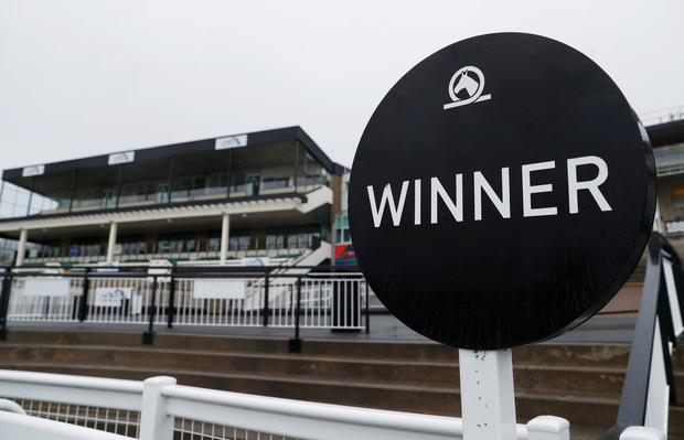 General view of a sign at Newcastle racecourse after the meeting is cancelled following the confirmed outbreak of equine flu Action Images via Reuters/Lee Smith