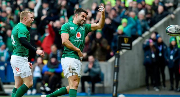 Ireland's Conor Murray (right) celebrates scoring his side's first try of the game during the Guinness Six Nations match at BT Murrayfield