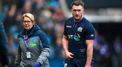 Scotland player Stuart Hogg leaves the field with an injury during the Guinness Six Nations match between Scotland and Ireland at Murrayfield on February 09, 2019 in Edinburgh, Scotland. (Photo by Stu Forster/Getty Images)