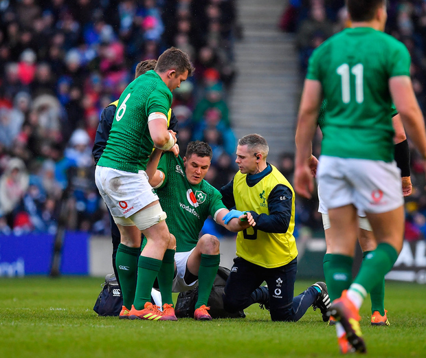Johnny Sexton is helped to his feet by Peter O'Mahony after receiving 'a bit of a stamp on the head' at Murrayfield. Photo: Brendan Moran