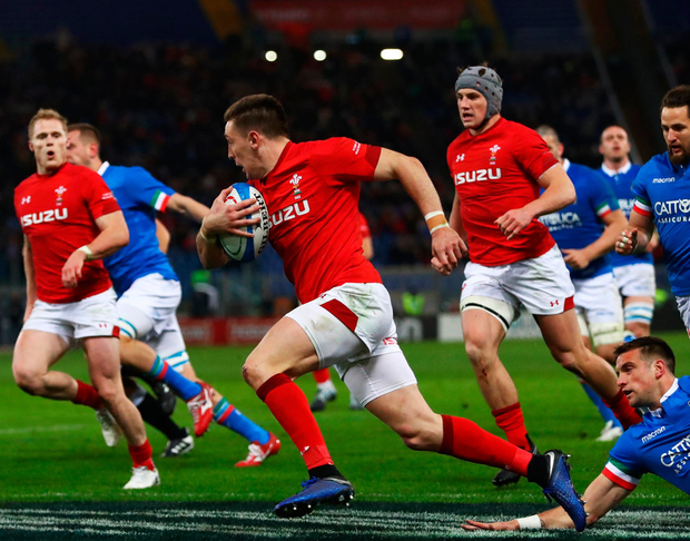 Josh Adams of Wales crosses to score their first try. Photo by Michael Steele/Getty Images
