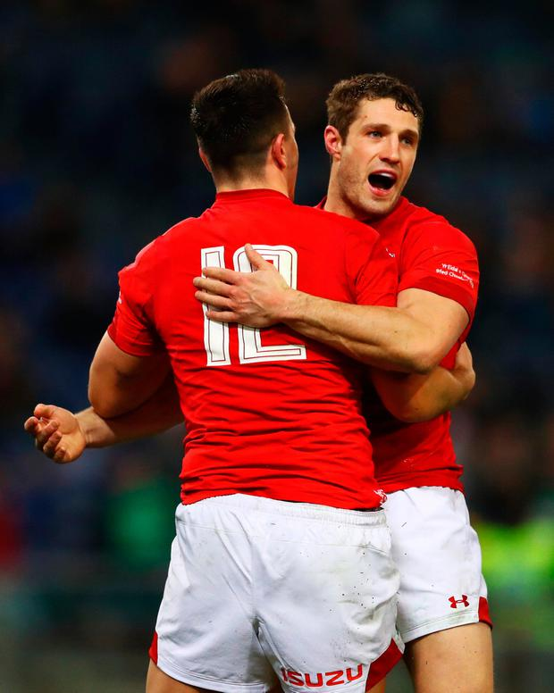 Owen Watkin of Wales (12) celebrates with Jonah Holmes as he scores their third try. Photo: Michael Steele/Getty Images
