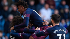 Arsenal's Alexandre Lacazette is mobbed by teammates after scoring his side's second goal. Photo: Getty Images