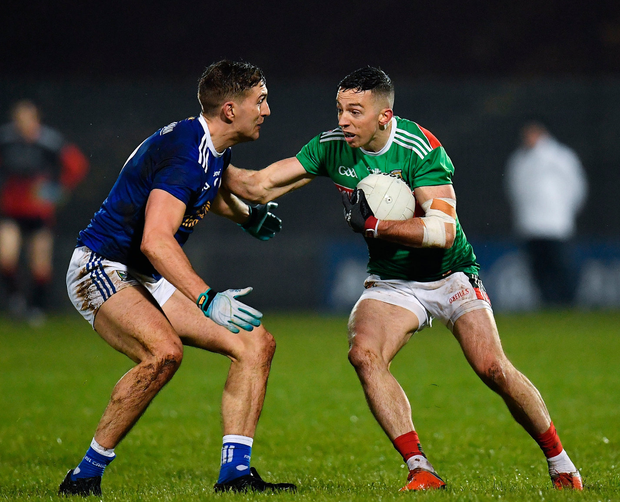 Evan Regan of Mayo in action against Killian Clarke of Cavan. Photo by Seb Daly/Sportsfile