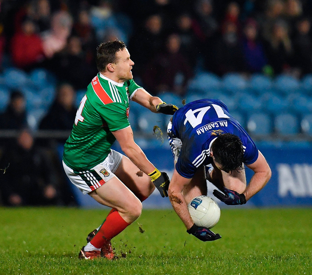 Thomas Galligan of Cavan in action against Andy Moran of Mayo. Photo by Seb Daly/Sportsfile