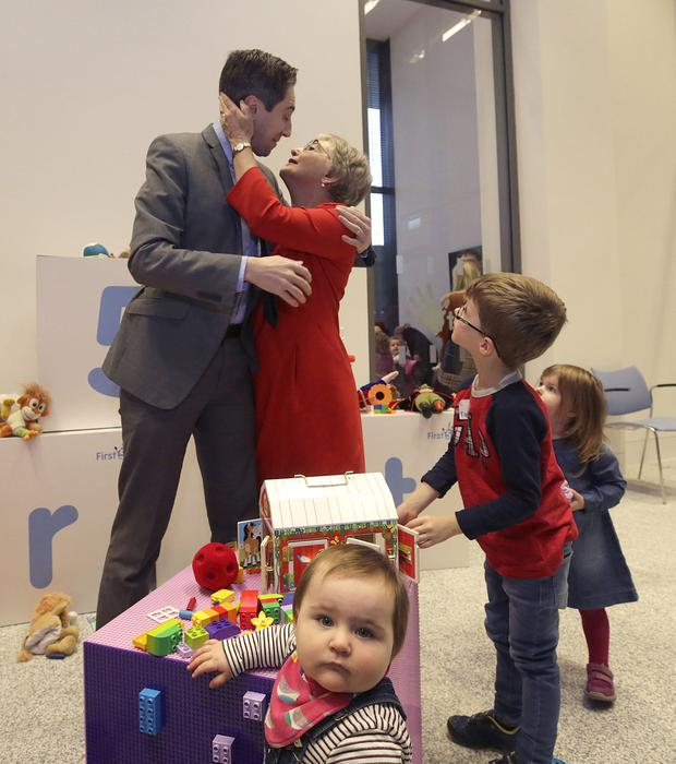 THE DANCE OF POLITICS: Minister for Children Katherine Zappone greets Minister for Health Simon Harris at a Fine Gael policy launch, as five-year-old Tadgh Litton and some younger children look on. Photo: Damien Eagers