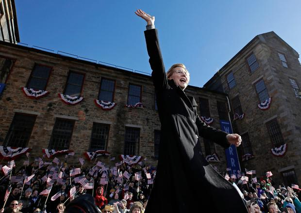Sen. Elizabeth Warren, D-Mass., waves to supporters as she takes the stage during an event to formally launch her presidential campaign, Saturday, Feb. 9, 2019, in Lawrence, Mass. (AP Photo/Elise Amendola)