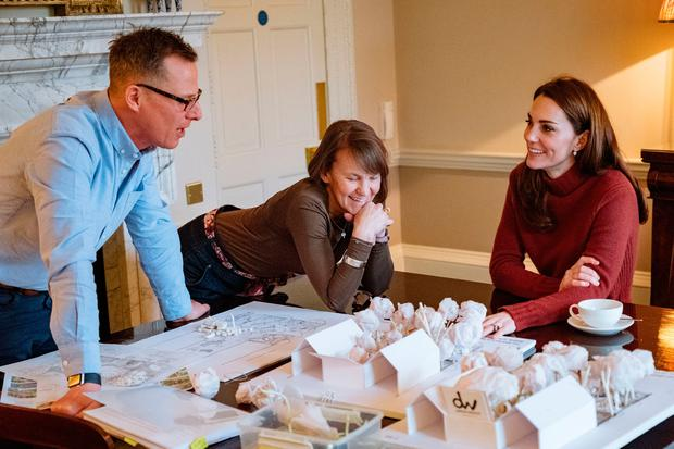 Undated Kensington Palace handout photo of the Duchess of Cambridge with Andree Davies (centre) and Adam White (left), of Davies White Landscape Architect, discussing plans for her