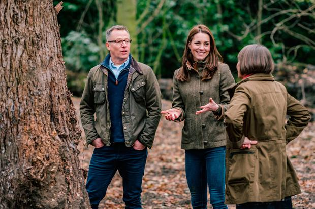 Undated Kensington Palace handout photo of the Duchess of Cambridge with Andree Davies (right) and Adam White (left), of Davies White Landscape Architect, discussing plans for her