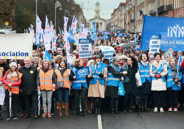 Nurses pictured during the rally at Merrion Square, in support of Nurses and Midwives pay Picture Credit: Frank McGrath
