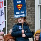 Five year old Kate Fitzpatrick pictured as she supports her Mum Anna [ who is a community Nurse in Meath] during the rally at Merrion Square, in support of Nurses and Midwives pay. Picture Credit:Frank McGrath 9/2/19