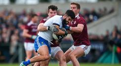 Neil McAdam of Monaghan in action against Jonathan Duane, left, and Gary O'Donnell of Galway during the Allianz Football League Division 1 Round 3 match between Monaghan and Galway at Inniskeen in Monaghan. Photo by Daire Brennan/Sportsfile