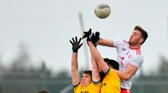 Brian Kennedy of Tyrone in action against David Murray, left, and Tadhg O'Rourke of Roscommon during the Allianz Football League Division 1 Round 3 match between Roscommon and Tyrone at Dr. Hyde Park in Roscommon. Photo by Seb Daly/Sportsfile