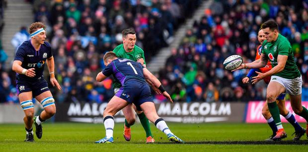 Jonathan Sexton of Ireland is tackled by Allan Dell of Scotland as he offloads a pass to team-mate Jacob Stockdale, who went on to score his side's second try from this move, during the Guinness Six Nations Rugby Championship match between Scotland and Ireland at the BT Murrayfield Stadium in Edinburgh, Scotland. Photo by Brendan Moran/Sportsfile