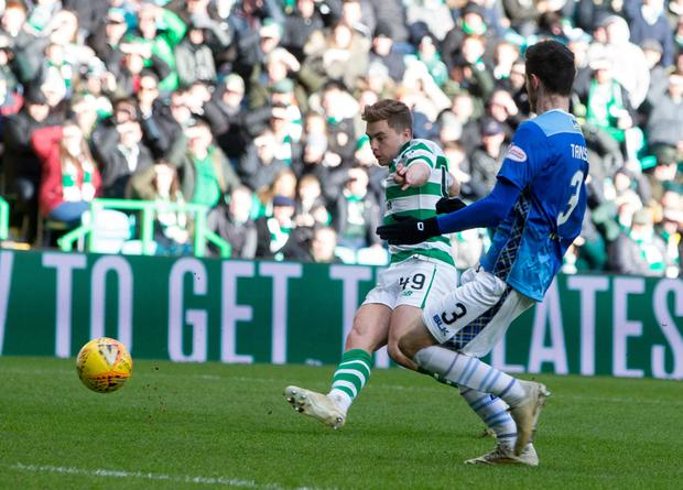 Celtic's James Forrest scores his side's third goal of the game. Photo: Jeff Holmes/PA Wire