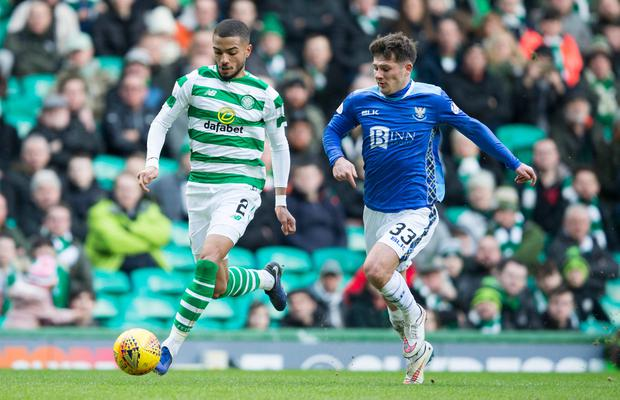 Celtic's Jeremy Toljan (left) and St Johnstone Matthew Kennedy (right) battle for the ball. Photo: Jeff Holmes/PA Wire