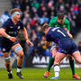 Taking one for the team: Johnny Sexton is tackled by Allan Dell of Scotland as he offloads a pass to Ireland team-mate Jacob Stockdale (right), who goes on to score his side's second try. Photo: Sportsfile