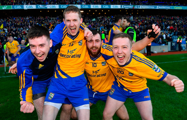 Beaufort players, from left, Jonathan Kissane, Ronan Ferris, Pádraig Doona, and Danny Healy celebrate after the AIB GAA Football All-Ireland Junior Championship Final. Photo: Piaras Ó Mídheach/Sportsfile