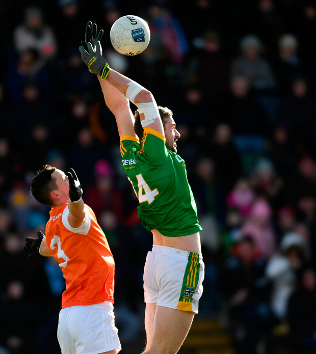 Michael Newman of Meath in action against Aaron McKay of Armagh. Photo: Sportsfile