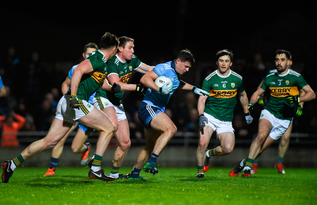 Brian Howard of Dublin is chased down by (from left) Kerry's Jack Barry, Tadhg Morley, Paul Murphy and Jack Sherwood in Tralee. Photo: Sportsfile