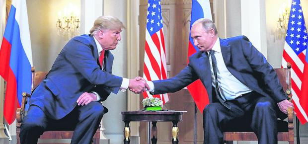 Nuclear option: US and Russian presidents Donald Trump and Vladimir Putin have suspended the Intermediate-Range Nuclear Forces Treaty. Photo: REUTERS/Kevin Lamarque
