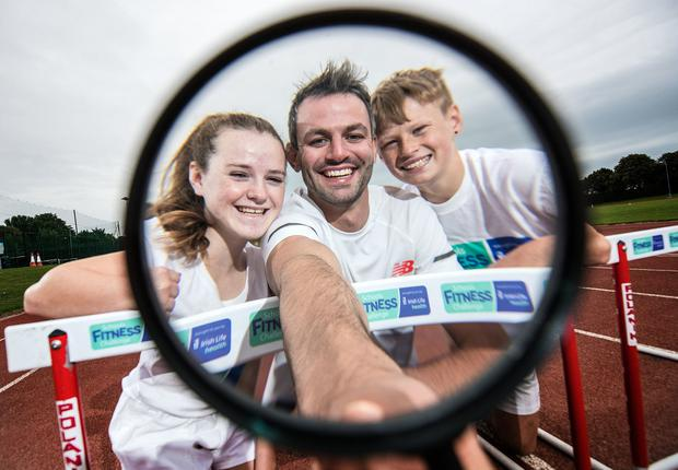Annual study: Irish Olympian Thomas Barr with Cameron Ramsay and Laragh Tierney of Newpark Comprehensive at the launch of the Irish Life Health Fitness Challenge. Photo: INPHO/Dan Sheridan