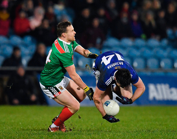 Down and out: Thomas Galligan loses his footing as he is challenged by Andy Moran at MacHale Park. Photo: Sportsfile