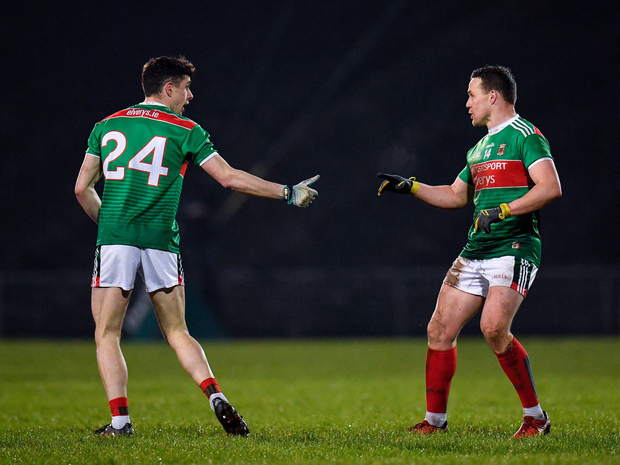 Ciaran Treacy of Mayo, left, comes on to replace team-mate Andy Moran, right. Photo: Sportsfile