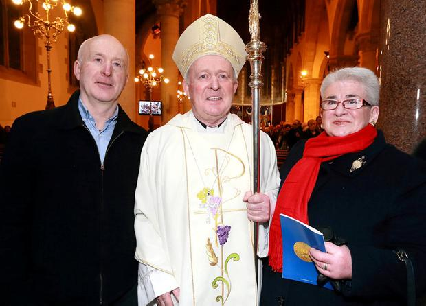 Proud: New Bishop of Clogher Larry Duffy with brother Peter and sister Anna. Photo: Frank McGrath