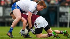 Tunnel vision: Galway's Antaine Ó Laoi keeps hold of the ball as he is tackled by Kieran Duffy during the Allianz Football League clash at Inniskeen. Photo: Sportsfile