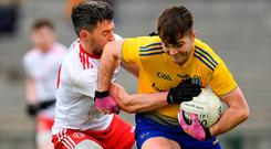 Get a grip: Roscommon's Ultan Harney tries to get away from Mattie Donnelly during the Allianz Football League match at Dr Hyde Park. Photo: Sportsfile