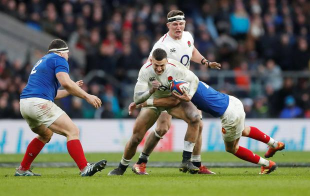 England's Jonny May in action with France's Romain Ntamack. Photo: Reuters/Matthew Childs