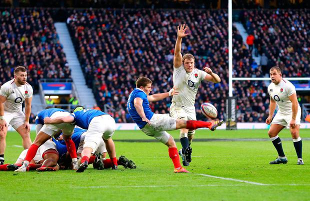 France's Antoine Dupont (centre) kicks the ball as England's Joe Launchbury trys to block it. Photo: Gareth Fuller/PA Wire