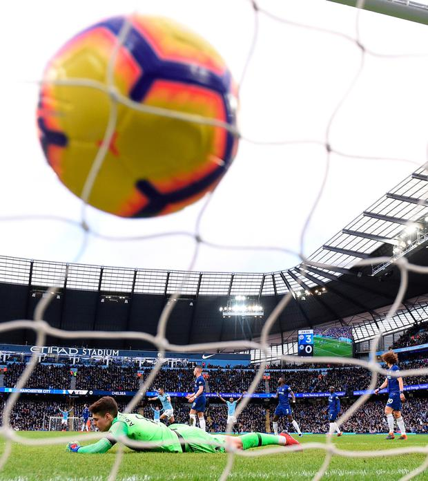 Ilkay Gundogan's shot flies into the net for the fourth goal. Photo by Laurence Griffiths/Getty Images