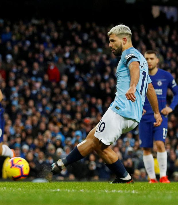 Aguero scores the fifth from the penalty spot. Photo: Reuters/Phil Noble