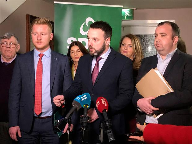 SDLP leader Colum Eastwood (centre) speaks to the media as his party has voted by more than two to one to back a new partnership with Fianna Fáil. Photo: Michael McHugh/PA Wire